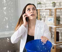 Worried woman looking at falling water on the phone