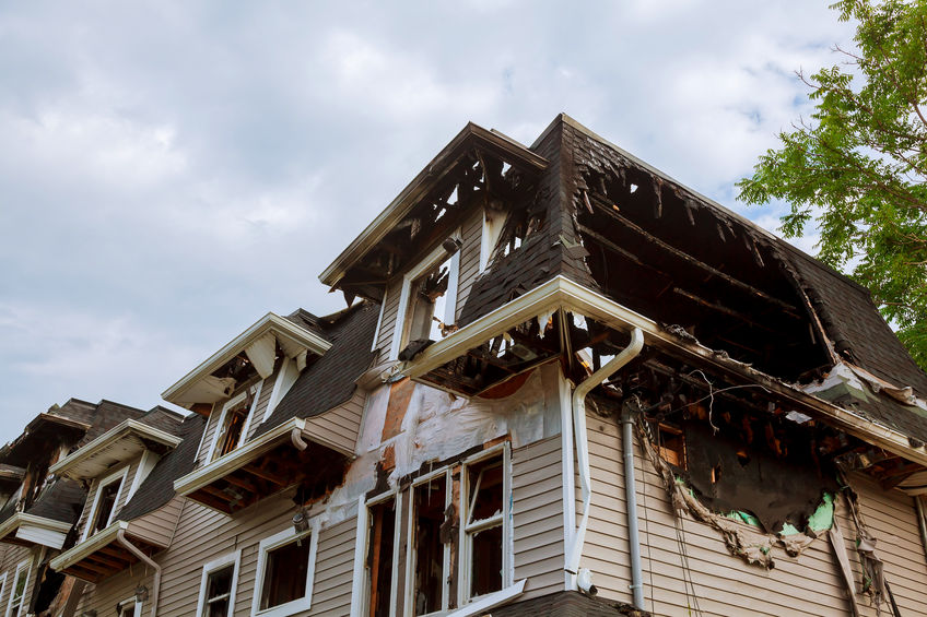 The exterior of a home showing fire damage.